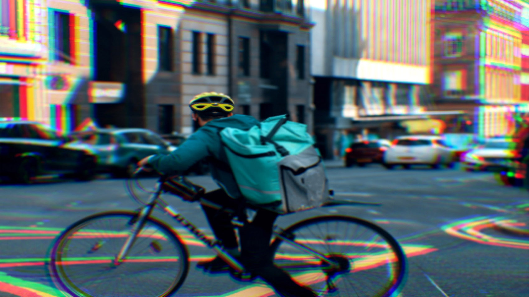A food delivery gig worker on a bicycle riding in a city street