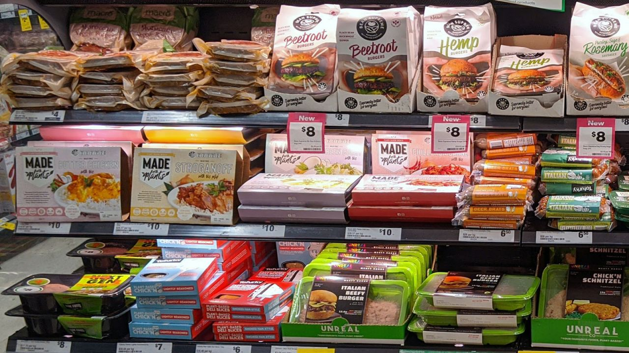 Pre-packaged meat alternatives in a supermarket refrigerated display case