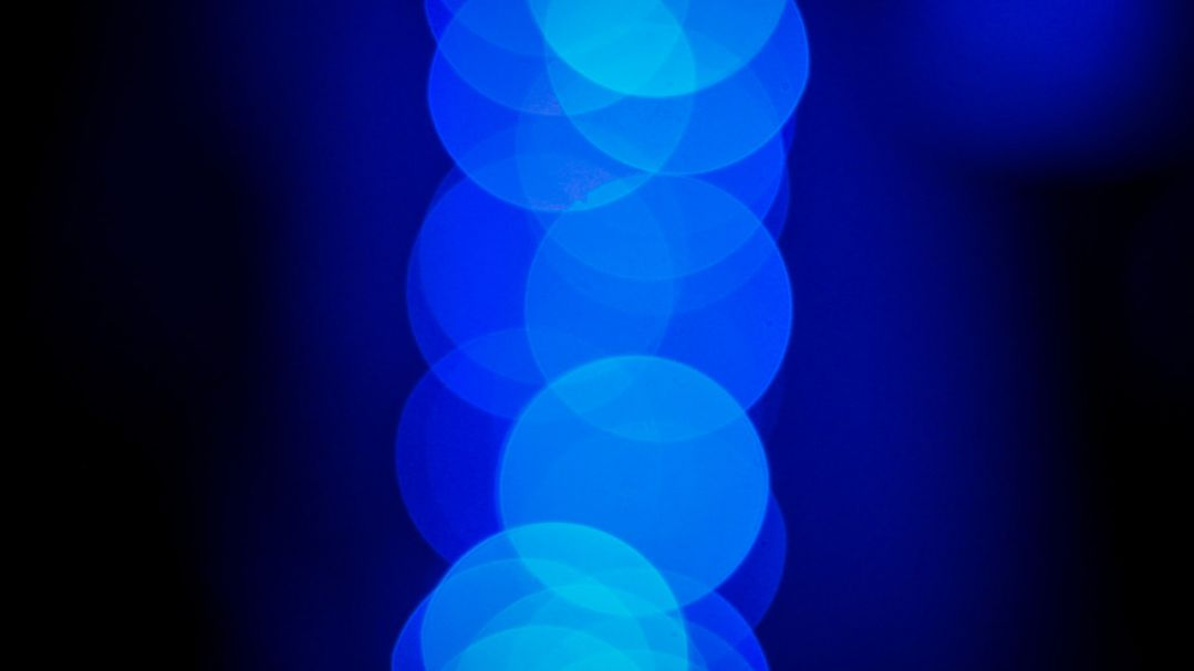 Blue bokeh made from crhistmas lights a projector and the night