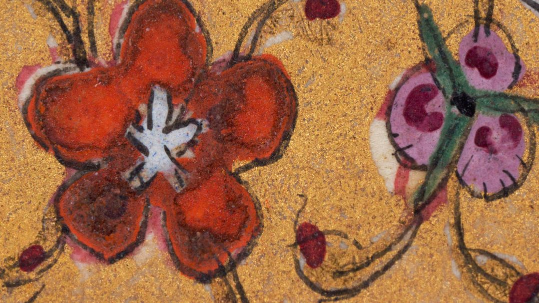 A close up of a colourful mixed media artwork of flowers and gold paint