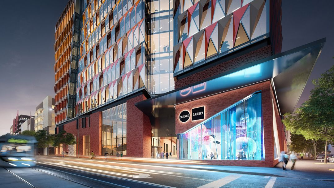 An artists impression of an exterior shot of a building lit up at night. Building has reflective glass facade and says science gallery