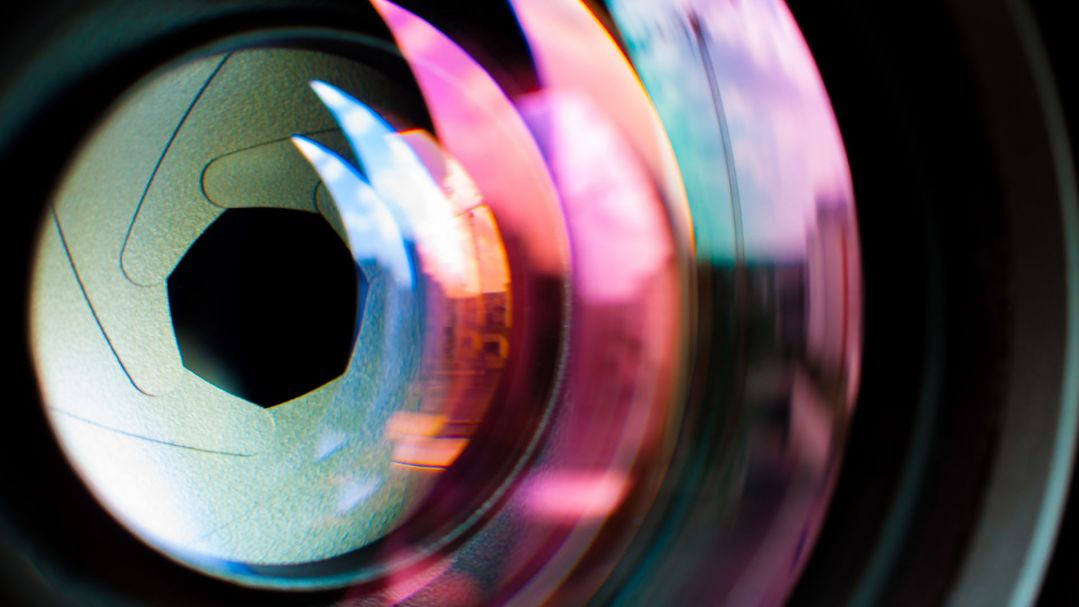 Close up of a camera lens with colour refraction