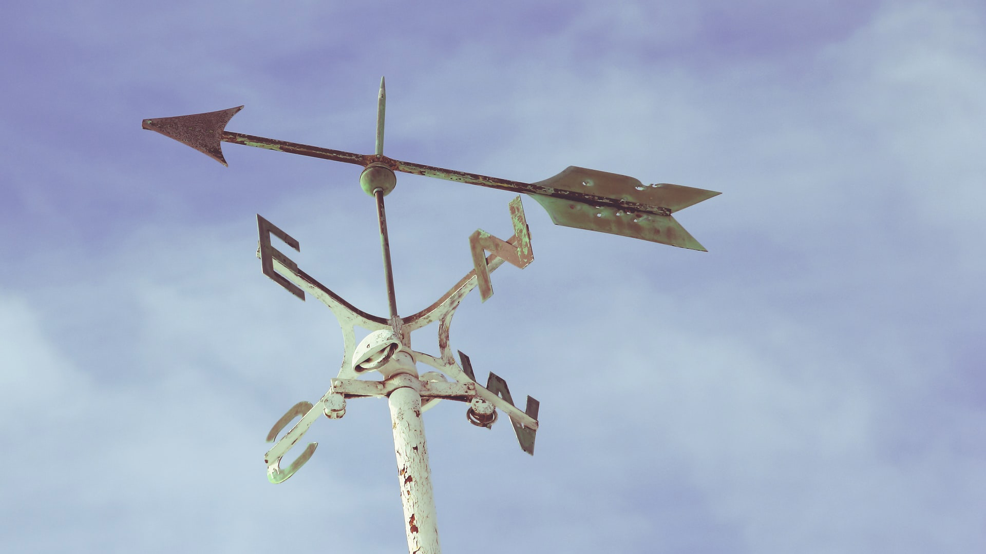 a weather vane showing the cardinal directions