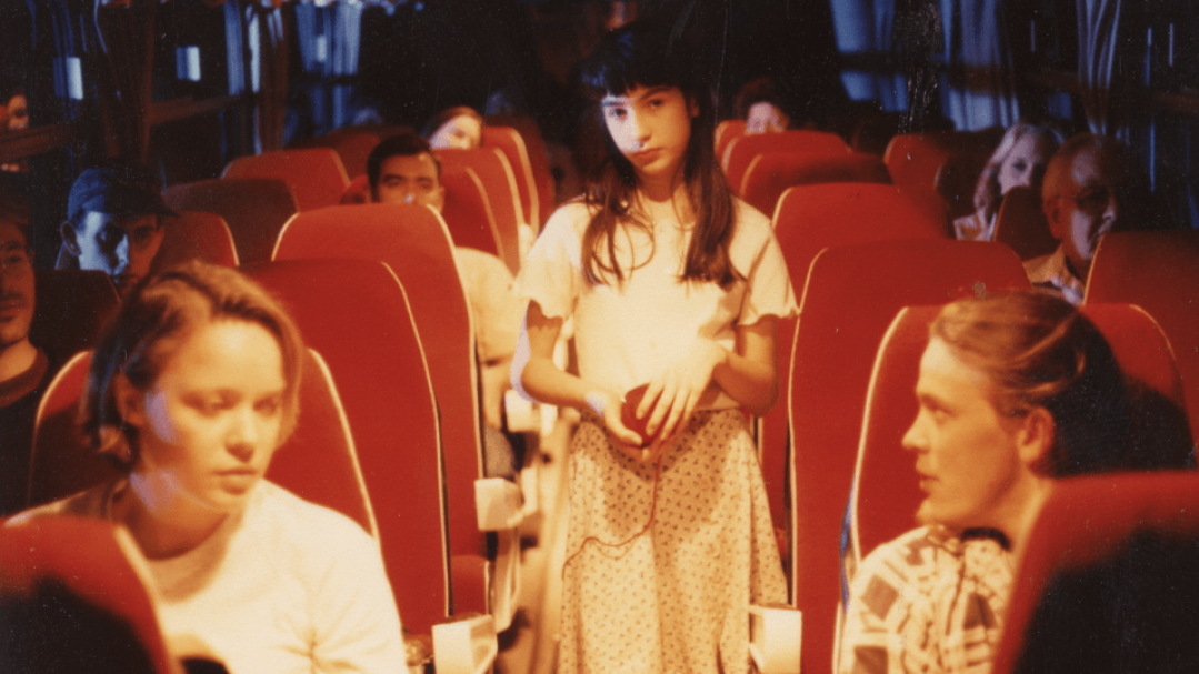 Video still from The Window Seat. 1994. Damian Corby. It shows young women on a bus at night