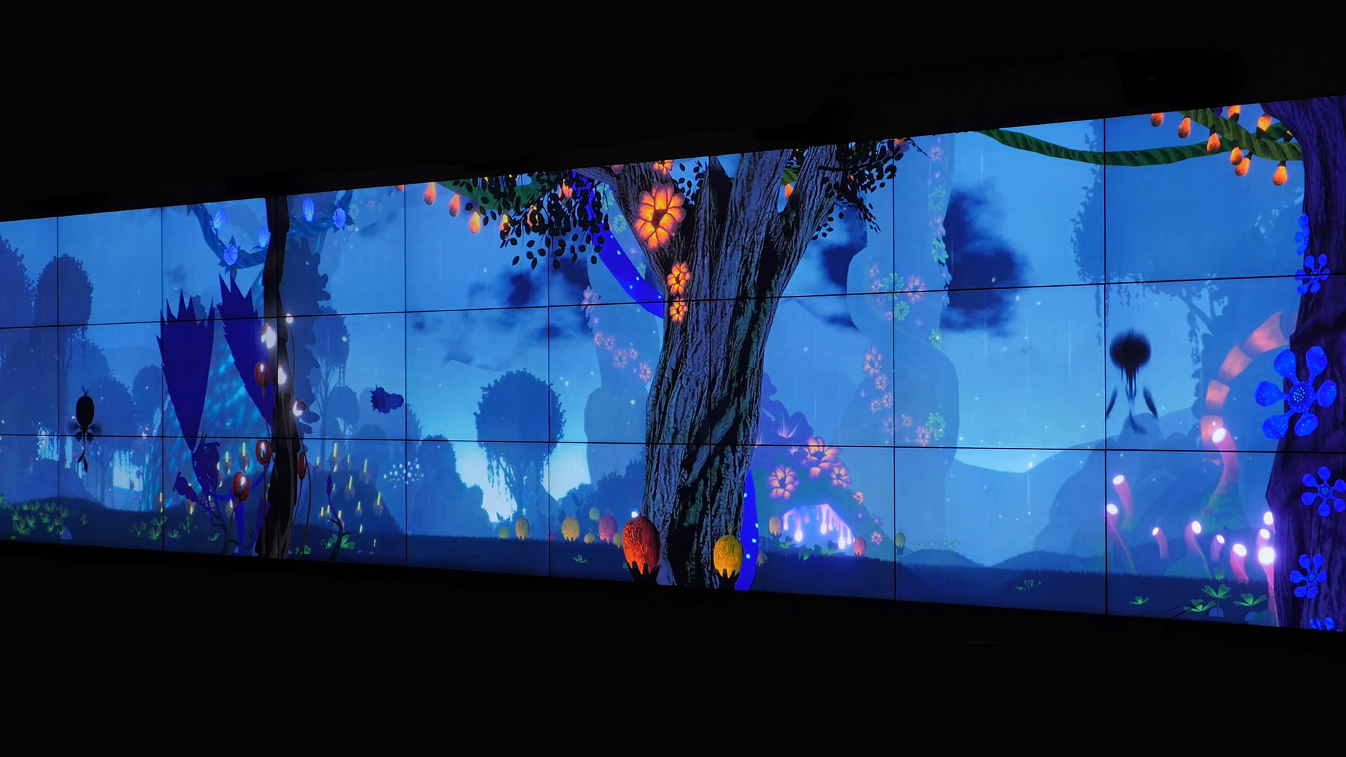 A blue backlit wall screen featuring a mythical forest