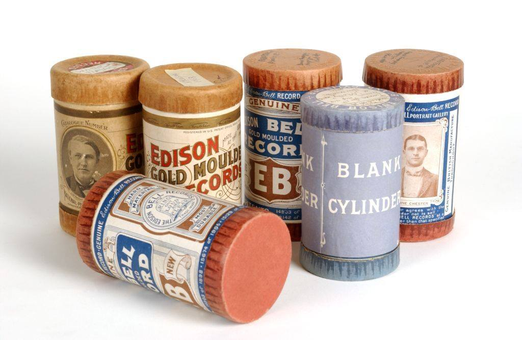 Five early 20th century wax cylinders side by side against a white background.