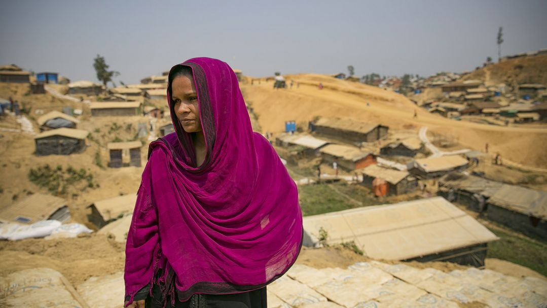 A woman in a purple scarf stands outside the Women's Centre in Balukhali camp