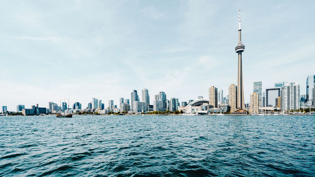 view of Toronto skyline with Lake Ontario in foreground