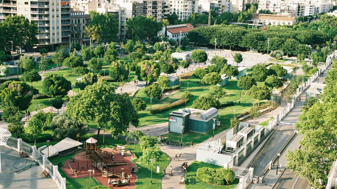 A greenspace in a city with playground, walking tracks and grass