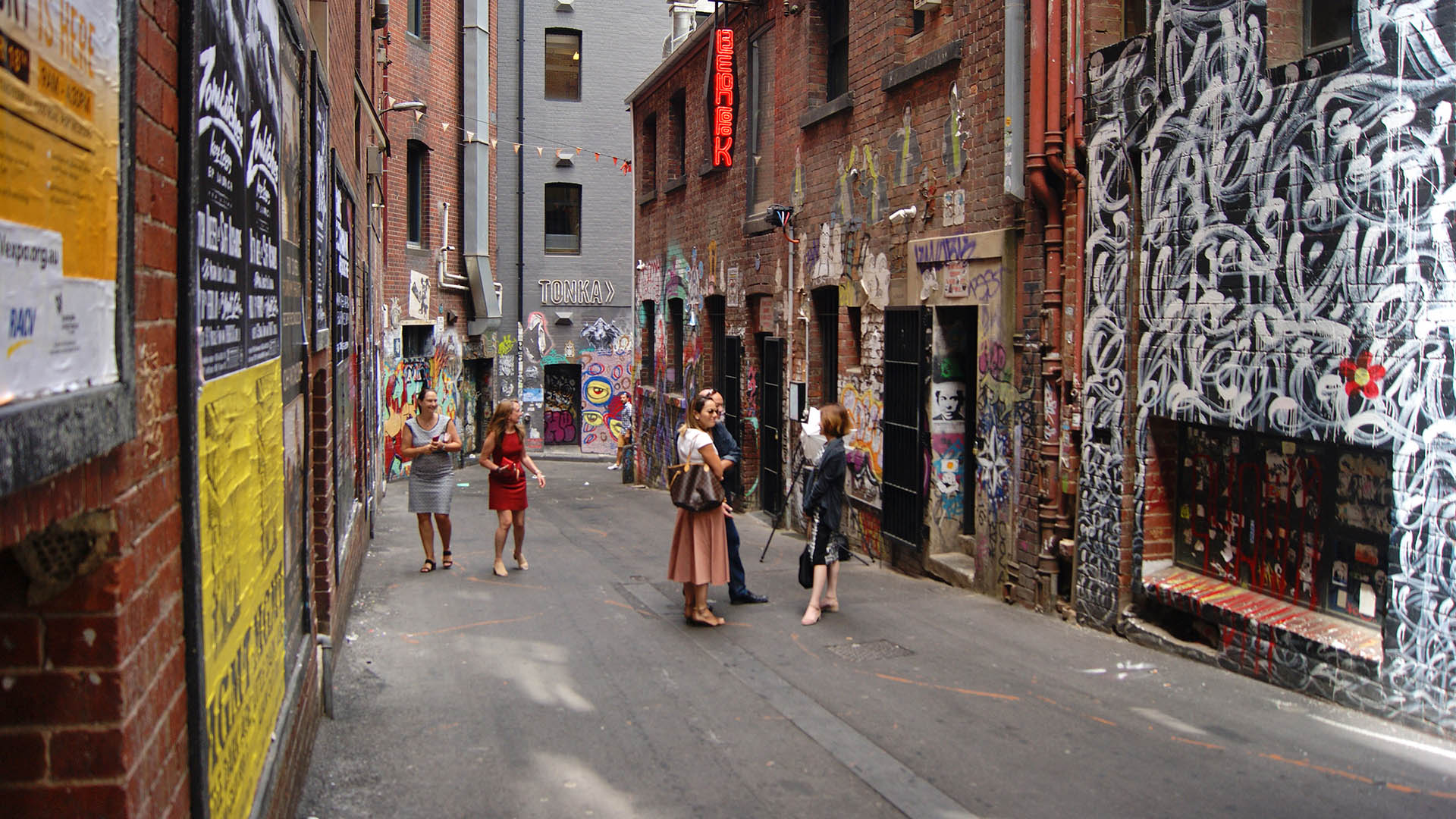 People milling about in Melbourne laneway