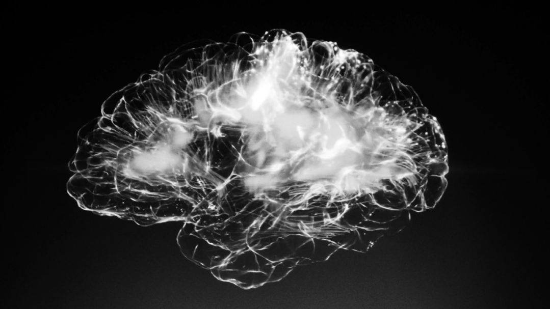 A black image with a lit up visual of brain neurons and pathways firing
