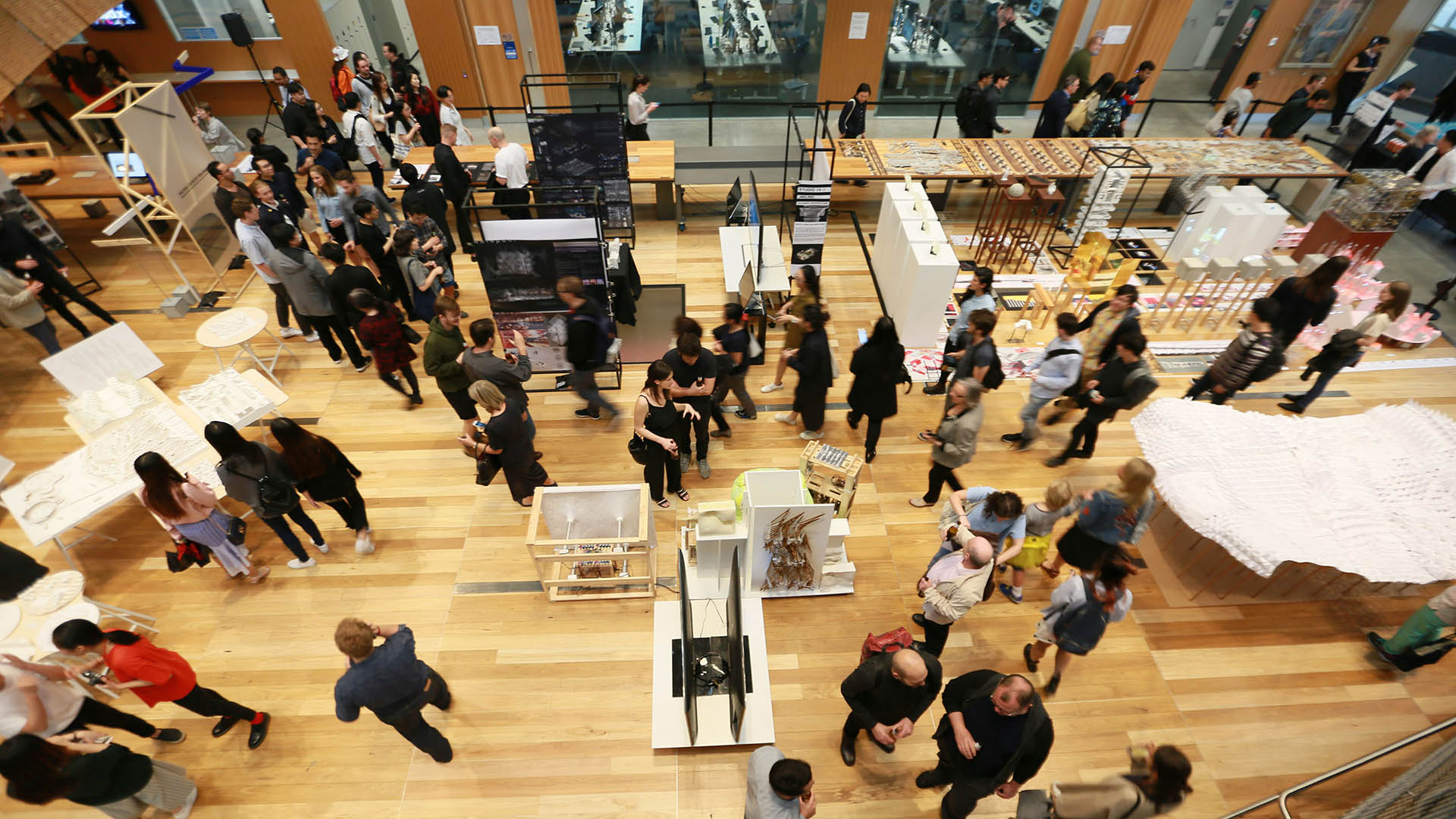 A birds eye view of a design expo in the architecture building