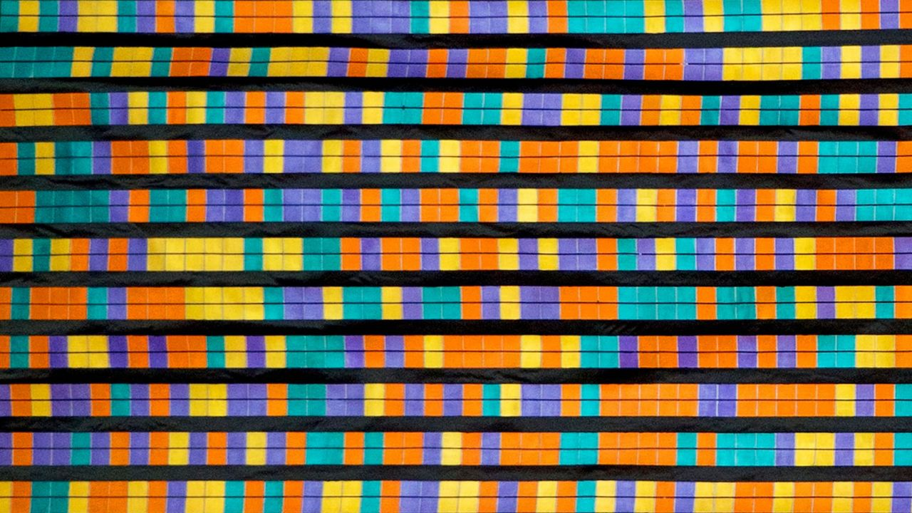 Painting of blue, yellow, orange and purple squares in a DNA sequence