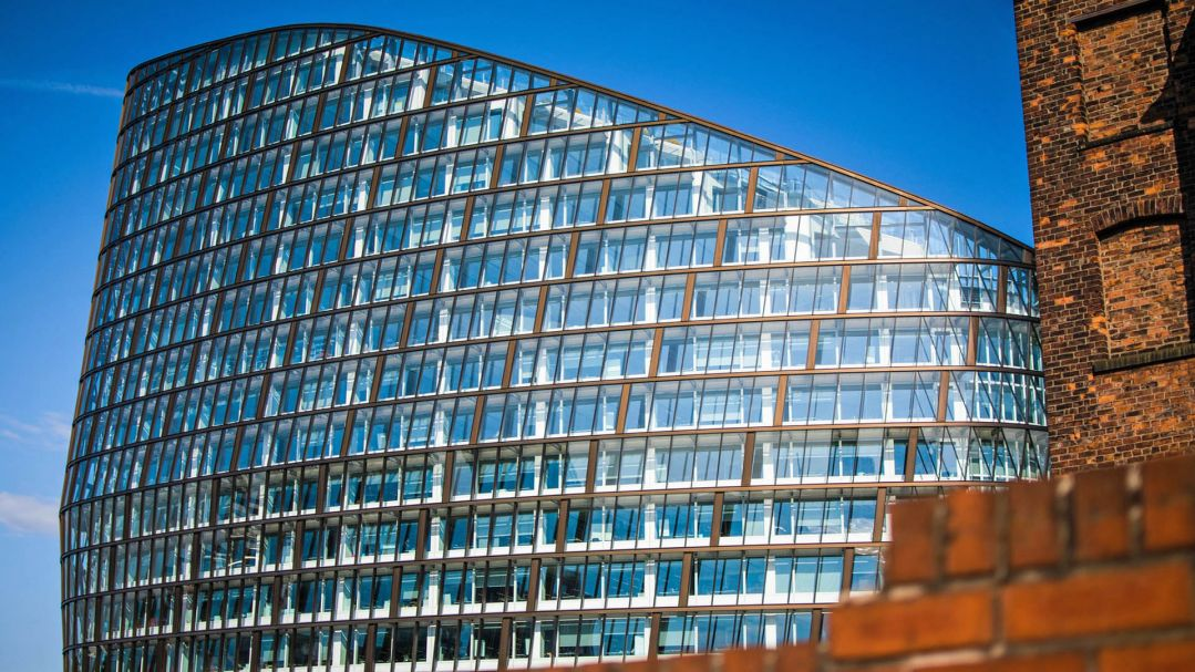 a modern architecturally designed glass building in Manchester
