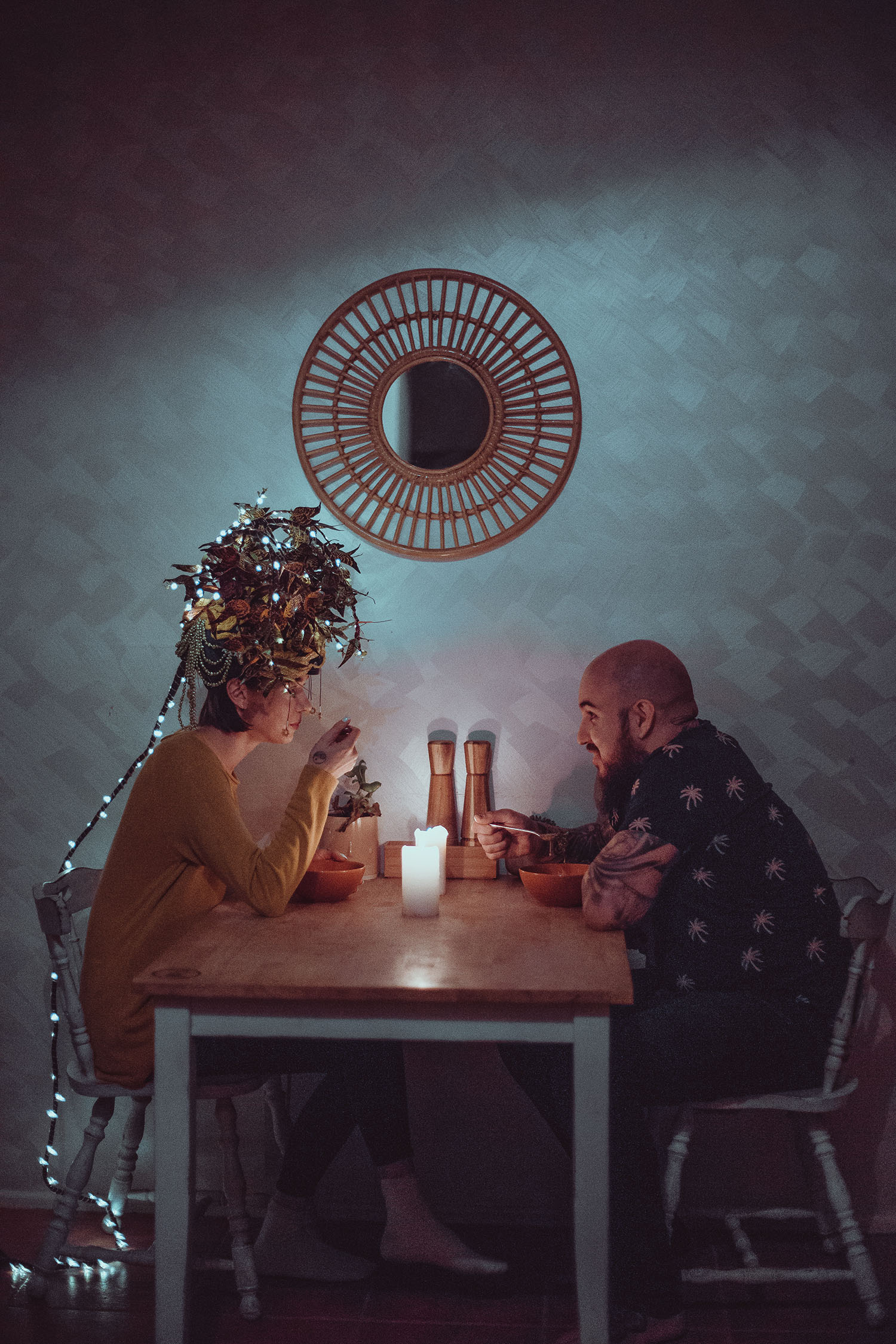 a woman and man sitting across from each other at a kitchen table