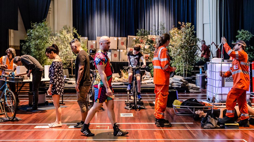 People in a town hall participating in an emergency services scenario